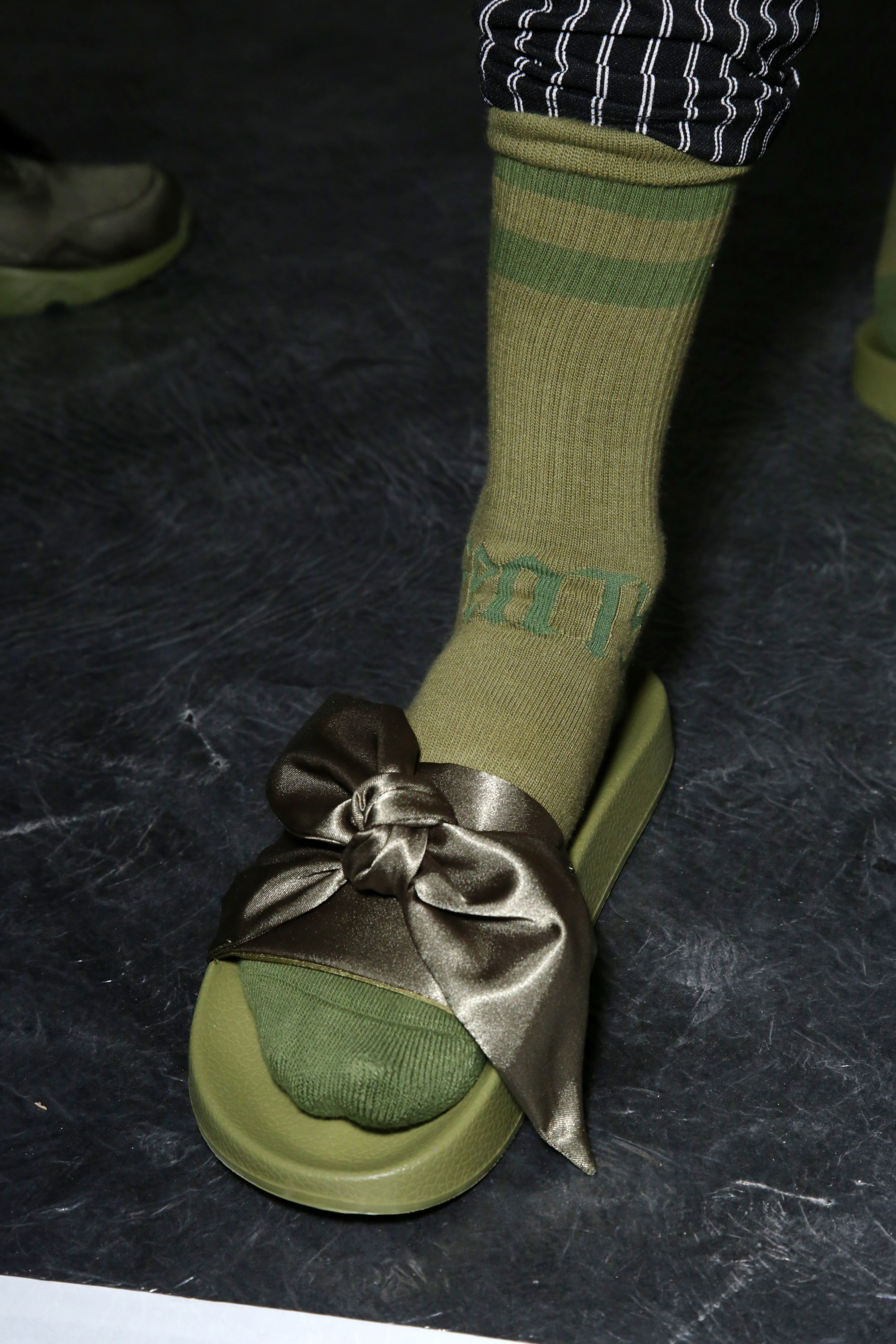 PARIS, FRANCE - SEPTEMBER 28: A model, shoe detail, is seen backstage during FENTY x PUMA by Rihanna at Hotel Salomon de Rothschild on September 28, 2016 in Paris, France. (Photo by Victor Boyko/Getty Images for Fenty x Puma)
