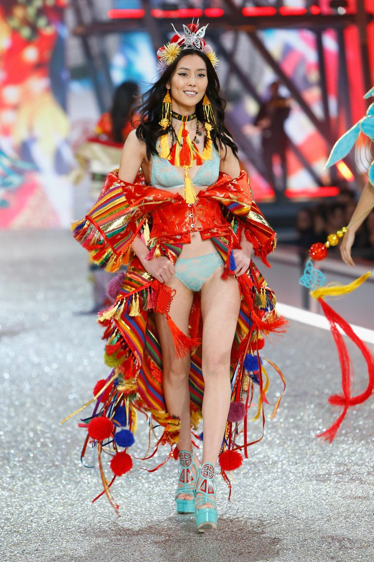 PARIS, FRANCE - NOVEMBER 30: Liu Wen walks on the runway with Swarovski crystals during Victoria's Secret Fashion Show on November 30, 2016 in Paris, France. (Photo by Julien M. Hekimian/Getty Images for Swarovski)