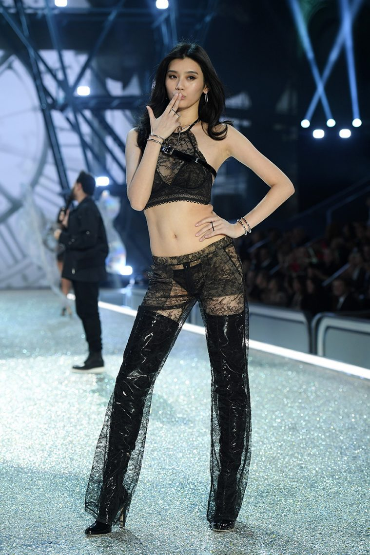 PARIS, FRANCE - NOVEMBER 30: Ming Xi walks the runway during the 2016 Victoria's Secret Fashion Show on November 30, 2016 in Paris, France. (Photo by Dimitrios Kambouris/Getty Images for Victoria's Secret)