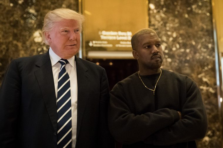 NEW YORK, NY - DECEMBER 13: (L to R) President-elect Donald Trump and Kanye West stand together in the lobby at Trump Tower, December 13, 2016 in New York City. President-elect Donald Trump and his transition team are in the process of filling cabinet and other high level positions for the new administration. (Photo by Drew Angerer/Getty Images)