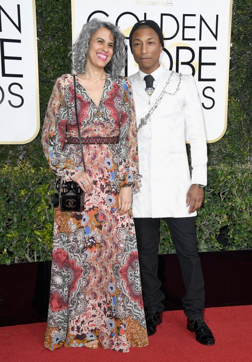 Pharrell Williams (R) and Helen Lasichanh
