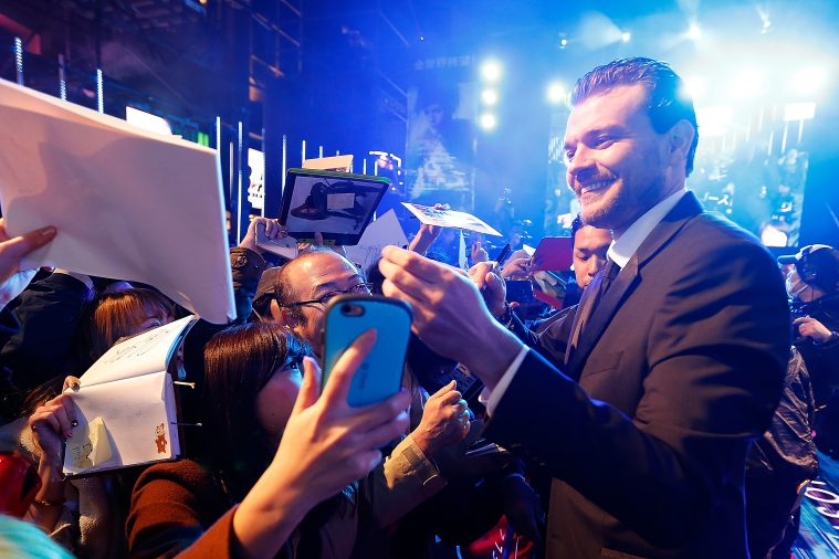 "TOKYO, JAPAN - MARCH 16: Pilou Asbaek signs autograph for fans at the World Premiere of the Paramount Pictures release ""Ghost In The Shell' at TOHO Cinemas Shinjuku on March 16, 2017 in Tokyo, Japan. (Photo by Christopher Jue/Getty Images for Paramount Pictures)"