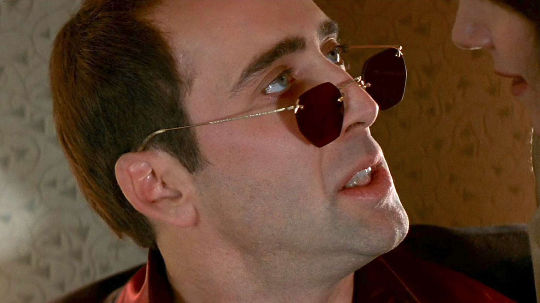 I vanvittige 'Face/Off' gjorde Nicolas Cage vildskaben mainstream